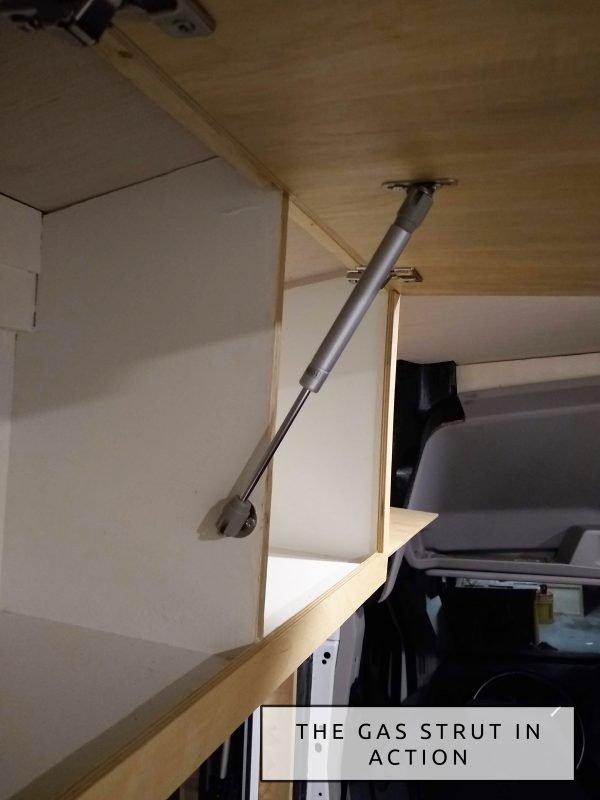 DIY Camper Van Conversion Upper Cabinets Hinges and Gas Strut Closeup